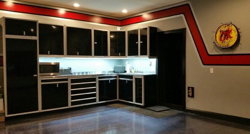 moduline signature black aluminum garage cabinets with under cabinet light shields and led lighting