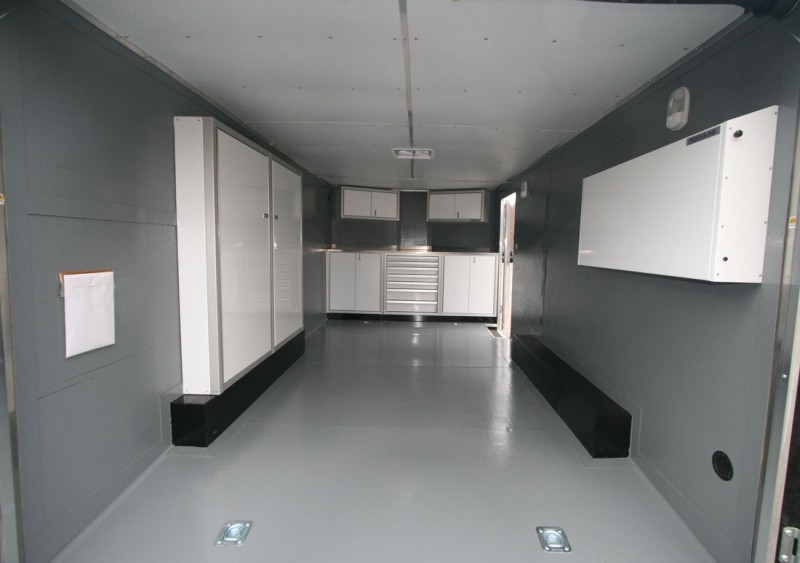 Moduline PROII™ Aluminum Cabinets Wheel Well Cabinets And Folding Workstation In A V Nose Trailer