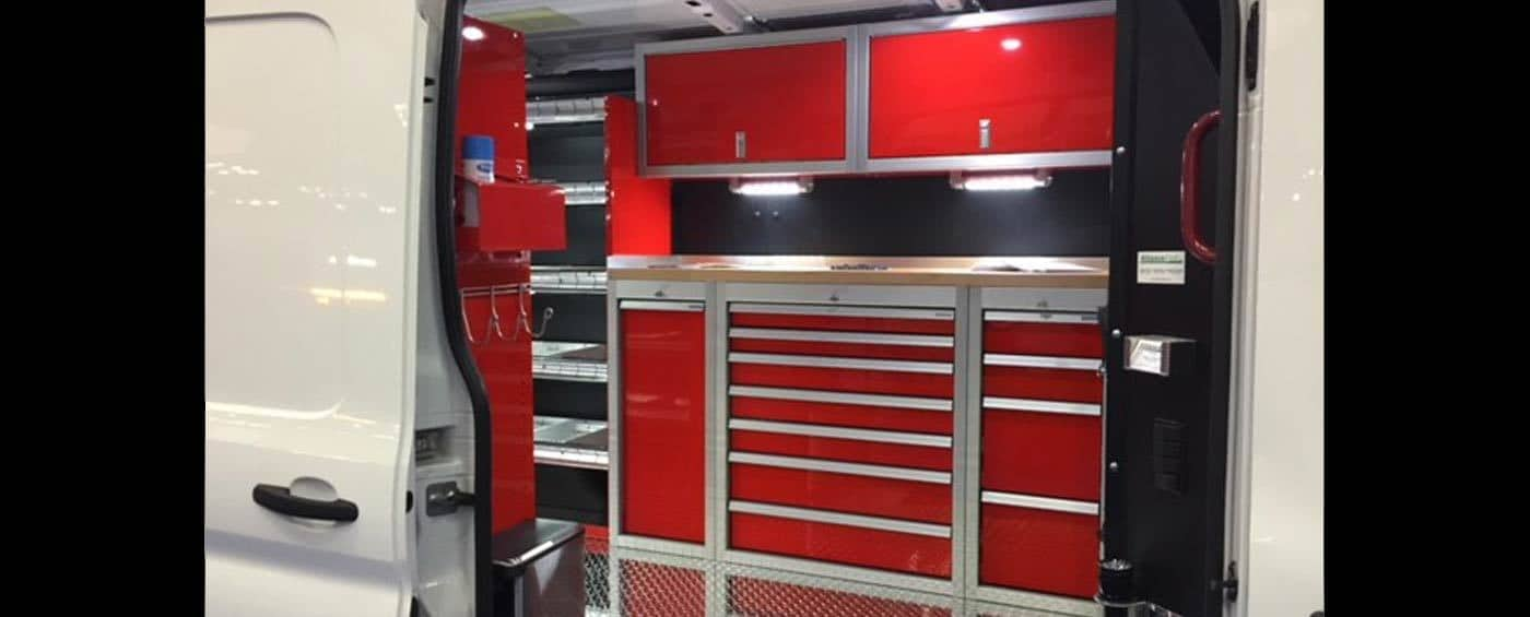 Red Moduline Cabinets in a Work Van