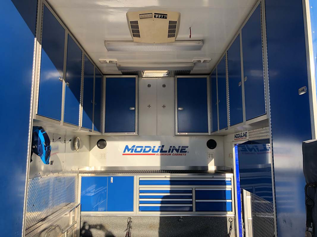 Moduline Blue Lightweight Aluminum Cabinets in Mover Trailer