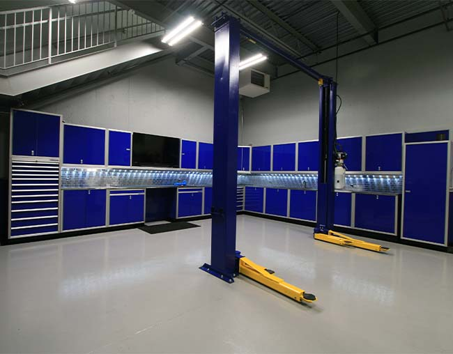 Blue Pro II Series cabinet setup in high end garage with auto lift
