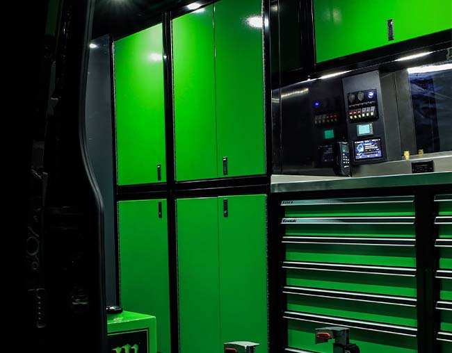Green ProII Series Cabinets with Black Frames in Motocross Van